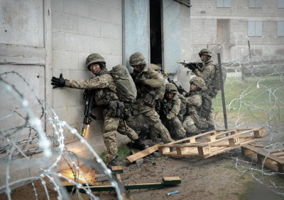 Trainee riflemen during a mock attack in Brecon, Wales
